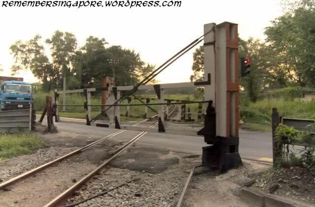one more ktm railway staff is responsible for activating the gates everyday for the trains to pass through