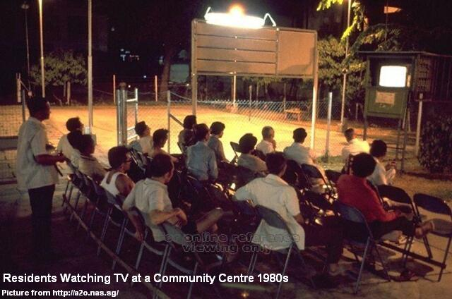 residents watching tv at community centre 1980s