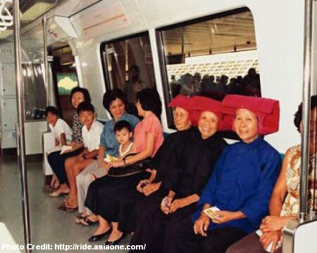 samsui women in mrt train on opening day 1987